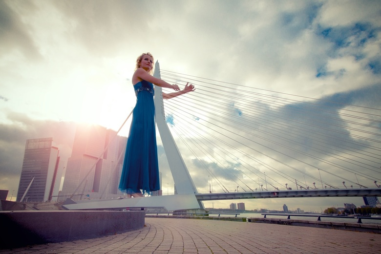 "Playing the city - ""It was a girl playing a harp, like in an orchestra. It was on this bridge in our city. And since it was breezy weather that w"