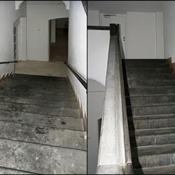 Een stukje van een stenen trappenhuis.