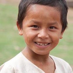 Faces of Cambodja -24- lachende jongen