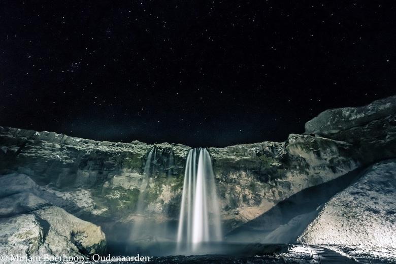 Seljalandsfoss waterfall by night