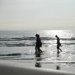 onthaasten aan het strand