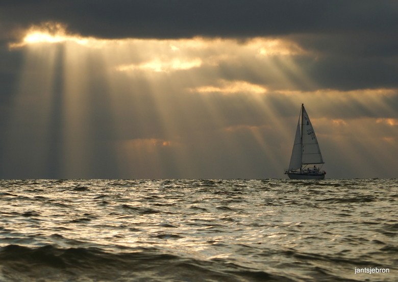 Sunbeams with a sailboat