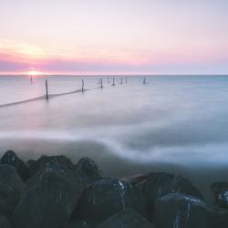 Zonsondergang bij visnetten