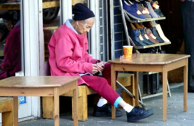 Wie de schoen past - Straatfoto in New York