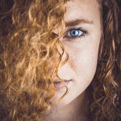 Sproeten, rood haar, blauwe ogen