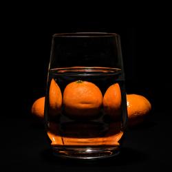 Glas en manderijnen