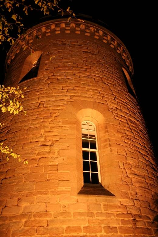 Dalhousie Castle by night - Mooie verlichte toren van Dalhousie Castle in Schotland.<br />