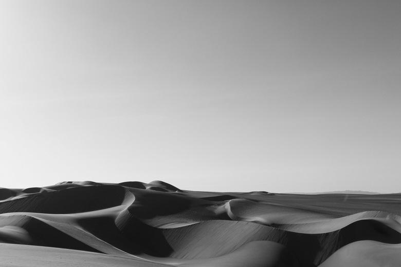 Tranquility - Vloeiende lijnen in de woestijn om de oasis Huacachina heen, in Peru.