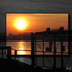 Zonsondergang bij de stuw in Belfeld