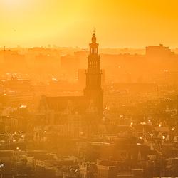 De Westerkerk badend in het goud.
