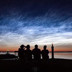 enjoying the view of shining night clouds