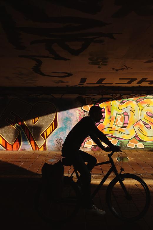 Passing by graffiti -