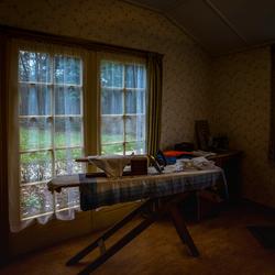 Kamer met strijkplank