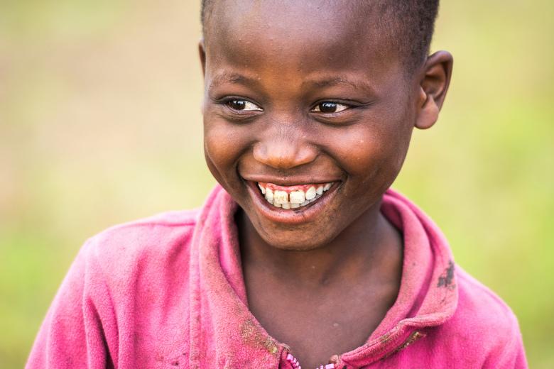 Celebrate every opportunity you get! - Celebrate life! Een stralende glimlach is van 100 meter al te zien. Dat is deze glimlach van een lokale jongen