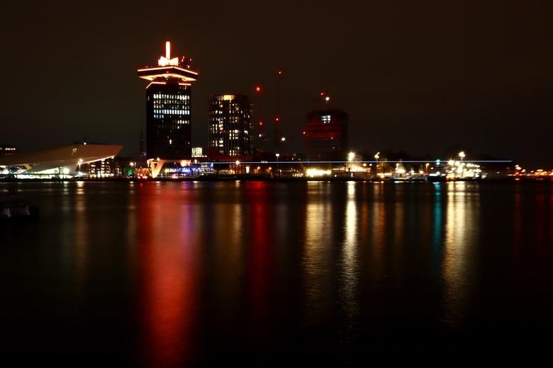 Amsterdam by night. Uitzicht over het IJ.  - Amsterdam by night. Uitzicht over het IJ.