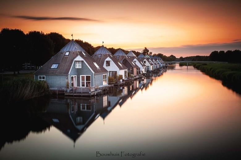 Watervilla's - De watervilla's in Almere Buiten bij zonsondergang.