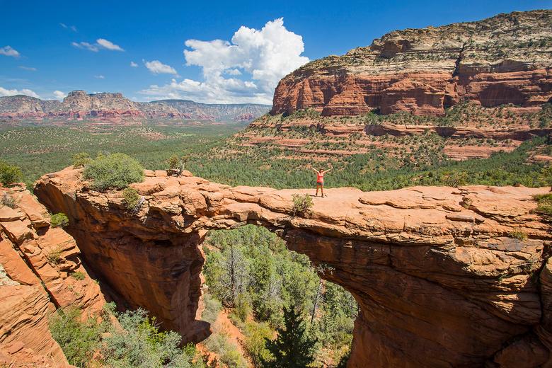Genieten - Heerlijk genieten van een prachtig uitzicht aan het einde van een zware wandeling