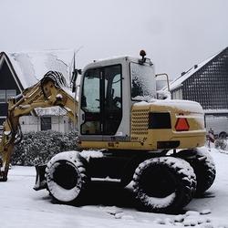 traktor in de sneeuw ….
