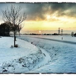 Zon boven de sneeuw
