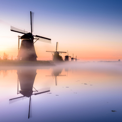 Dutch mills of Kinderdijk during sunrise