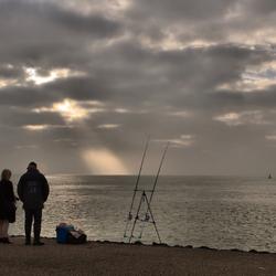 de fotografe en de visser