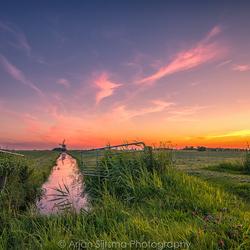 Hollands landschap, met in de verte de Klaarkampstermolen