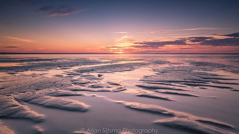 Zonsondergang over het Noordzeestrand