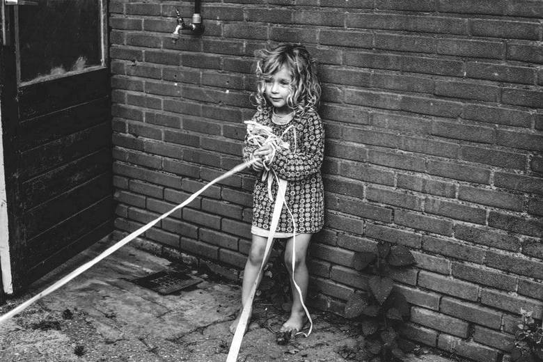 marking her playground with tape  -