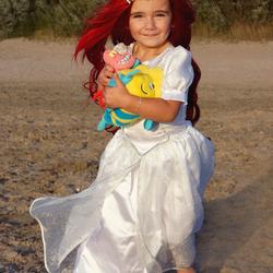 Prinses Ariël op het strand