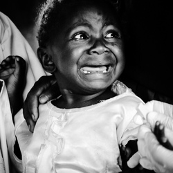 Scared girl at medical checks (for children) in Kenya 2015