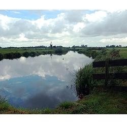 Wolken en een landschap: Holland