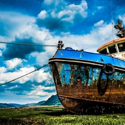 Fishing boat stuck on dry land