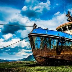 Fishing boat stuck on dry land