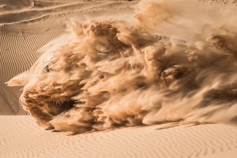 Breaking through the dunes - Vladimir Vasiliev breaking through the dunes with his Mini during the Africa Eco Race in Mauritania
