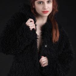 redhead in a black coat