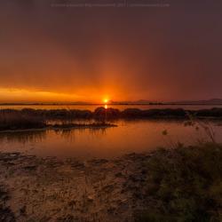 Rainy sunset by the salt lake on Kos Island Greece