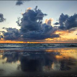 Reflecties bij zonsondergang