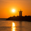 havenhoofd met zonsondergang