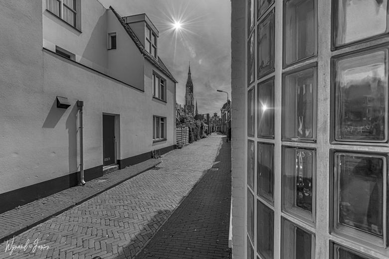 Cellebroerstraat - Leuke doorkijk naar de nieuwe kerk in Delft.