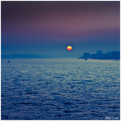 Ondergaande zon in de haven