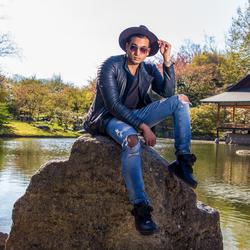 Mr Sanjay on a rock