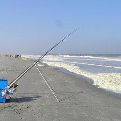 Vissers en gratis SLAGROOM op het strand