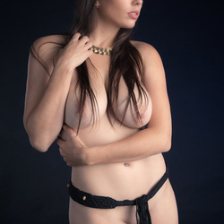 dressed in jewelry and stockings