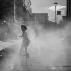 Little girl in the fog