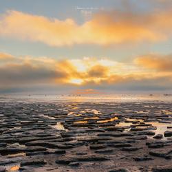 zonsondergang bij wadden zee