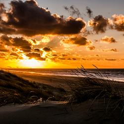 Scheveningen strand en duinen zonsondergang