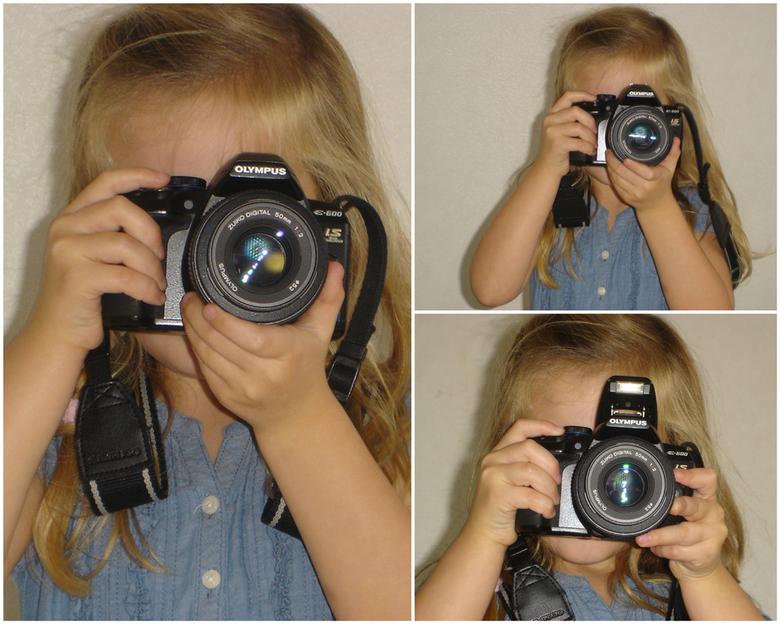 Lisa  - Lisa vind fotograferen ook heel leuk.Hier zie je haar met mijn camera Hoe ze het vasthoud niks gezegd wel opgelet.Oma de foto is wat mistig (d