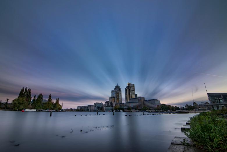 Zonsopkomst Amstel - Zonsopkomst bij de Amsteltoren in Amsterdam.