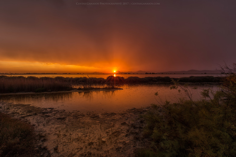 Rainy sunset by the salt lake on Kos Island Greece