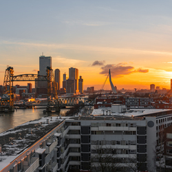 Golden hour in a snowcovered Rotterdam